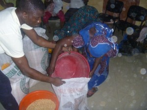 A woman collects her portion of maize.