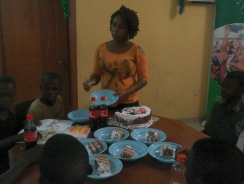 Ufuoma cuts and shares the birthday cake